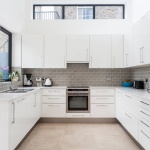 White-Kitchen-with-beige-tiles