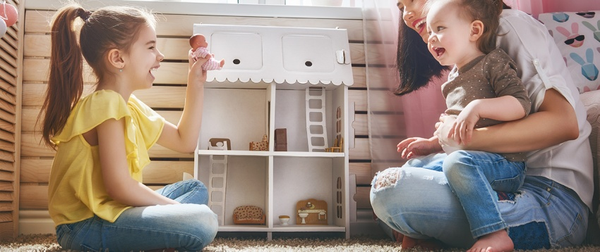 controlling-humidity-in-your-home-lady-playing-with-her-two-children-on-flooring
